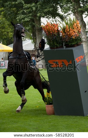 BRATISLAVA, SLOVAKIA - AUGUST 5: OTSCHMAIER Wolfgang on horse ROYAL KING OF DARKNESS fails on first hurdle during qualification to Grand Prix CSIO-W*** August 5, 2010 in Bratislava, Slovakia