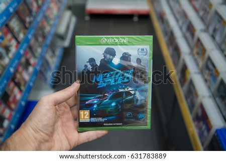 Bratislava, Slovakia, circa april 2017: Man holding Need for speed videogame on Microsoft XBOX One console in store #631783889