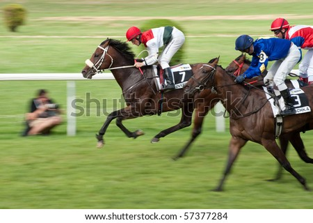 BRATISLAVA, SLOVAKIA - JULY 18: jockey Gary Hind on horse Overdose (GB) won Mysa Trophy race - part of 18th Slovak Derby on  July 18, 2010 in Slovakia