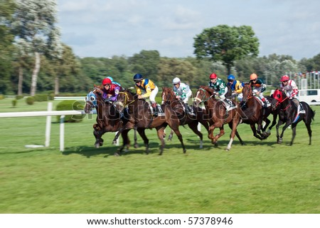 BRATISLAVA, SLOVAKIA - JULY 18: Trinity (GER) is ridden by J. Linek #11 to the line to finish close to Golden Eagle (GB) ridden by M. Srnec #10 on Bratislava mile horserace, on July 18, 2010 in Slovakia