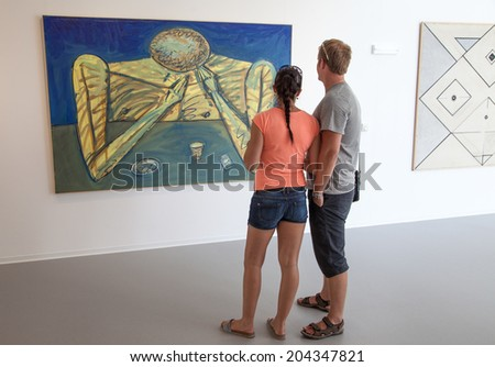 BRATISLAVA, SLOVAKIA - JUN 28: People looking at the picture in the museum of new art Danubiana in city Bratislava on Jun 28, 2014 in Bratislava