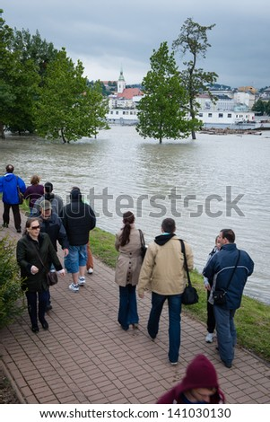 BRATISLAVA, SLOVAKIA - JUNE 4:  People watch as water level of the Danube river is rising on the Petrzalka side of the Danube on June 4, 2013 in Bratislava