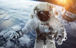 Brave astronaut at the spacewalk at the Earth orbit. People in space. Elements of this image furnished by NASA