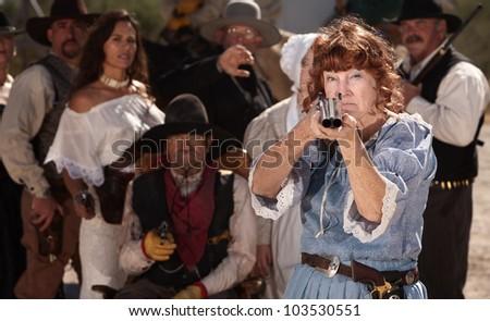 Brave grandmother points her double barrel shotgun