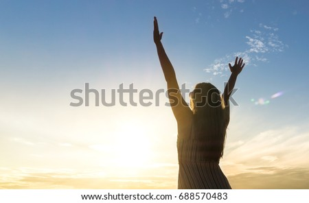 Brave happy young woman raising hands up in the air and open arms to sky. Enjoying life. Sunny healthy lifestyle concept in sunset. #688570483