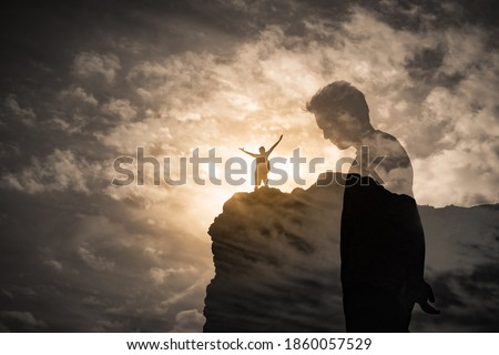 Brave man standing on a mountain overcoming his fears, self doubt, mental depression, sadness concept. double exposure