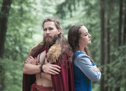 Brave Warrior Viking man with beautiful medieval woman standing outdoor