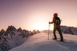 Brave woman exploring high Alpine mountains