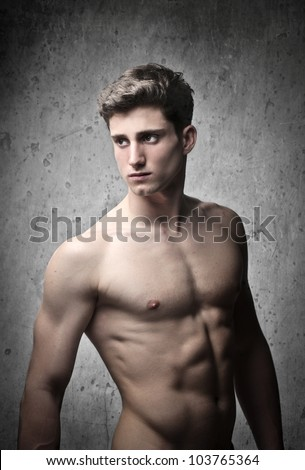 Brawny bare-chested handsome young man