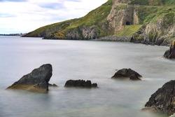 Bray to Greystones Cliff Walk. Long-exposure shot of coastal line in Bray, Co. Wicklow, Ireland