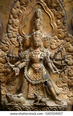 Brazen relief, sculpture of Shiva the destroyer in Patan's Durbar square. Kathmandu, Nepal