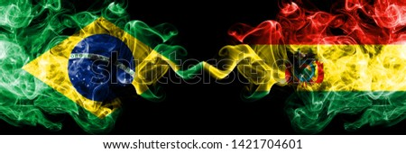 Brazil, Brazilian, Bolivia, Bolivian, competition thick colorful smoky flags. America football group stage qualifications match games