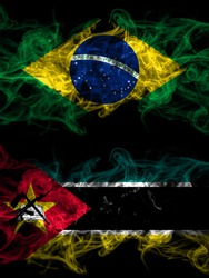Brazil, Brazilian vs Mozambique, Mozambican smoky mystic flags placed side by side. Thick colored silky abstract smoke flags.