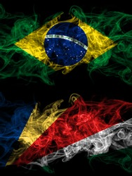 Brazil, Brazilian vs Seychelles, Seychellois smoky mystic flags placed side by side. Thick colored silky abstract smoke flags.