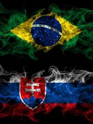 Brazil, Brazilian vs Slovakia, Slovakian smoky mystic flags placed side by side. Thick colored silky abstract smoke flags.