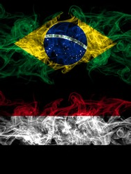 Brazil, Brazilian vs Yemen, Yemeni smoky mystic flags placed side by side. Thick colored silky abstract smoke flags.