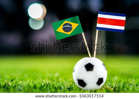 Brazil - Costa Rica, Group E, Friday, 22. June, Football, World Cup, Russia 2018, National Flags on green grass, white football ball on ground. #1063017554