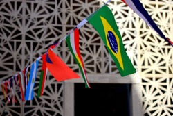 Brazil flag in focus, with others flags in background including Kurdistan's flag