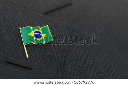 Brazil flag lapel pin on the collar of a business suit jacket shows patriotism
