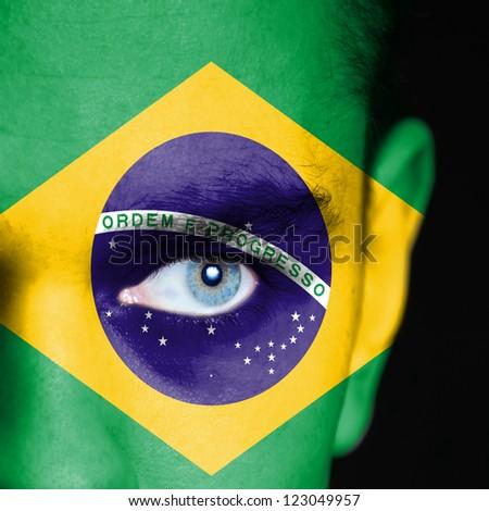 Brazil flag on man face