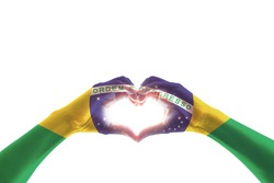Brazil flag on people hands in heart shape for labor day national holiday celebration and pray for Brazilian isolated on white background