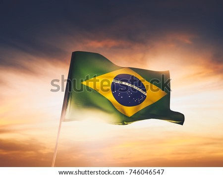 brazil flag waving with pride at sunset /high contrast image #746046547