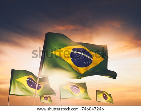brazil flags waving with pride at sunset /high contrast image #746047246