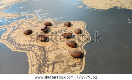 Brazil map, on top of coffee beans.