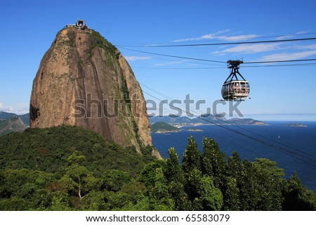 Brazil, Rio de Janeiro, Sugar Loaf Mountain - Pao de Acucar and cable car with the bay and Atlantic Ocean in the background. The city is the venue for the 2016 Olympic Games.