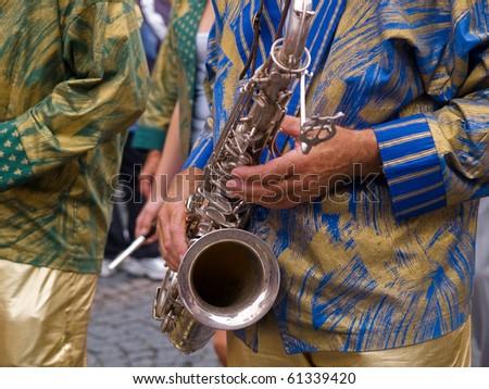 Brazil Rio Samba Carnival style saxophone player musician in a street concert