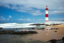 Brazil, Salvador, the Farol De Itapua (lighthouse) on the rough sea