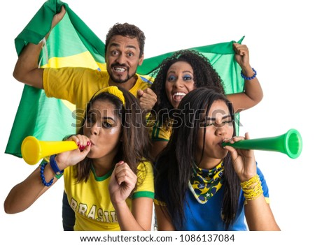 Brazil supporters. Brazilian group of fans celebrating on soccer / football match on white background. Brazil colors. Person is blowing a horn. Flag.