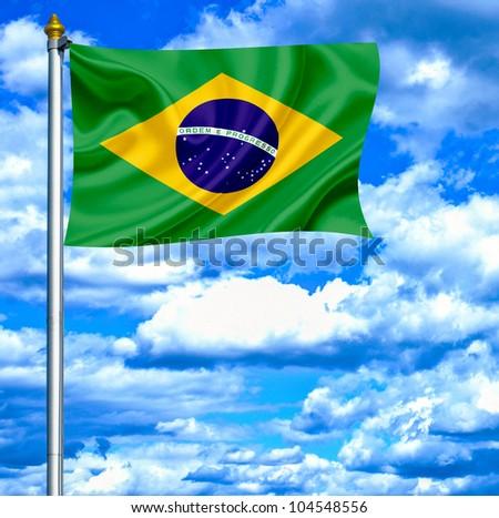 Brazil waving flag against blue sky