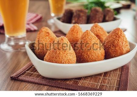 Brazilian appetiser coxinha de frango and two glass of beer Stock photo ©