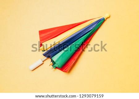 """Brazilian Carnival concept. Colorful """"Frevo"""" umbrella over yellow background. #1293079159"""