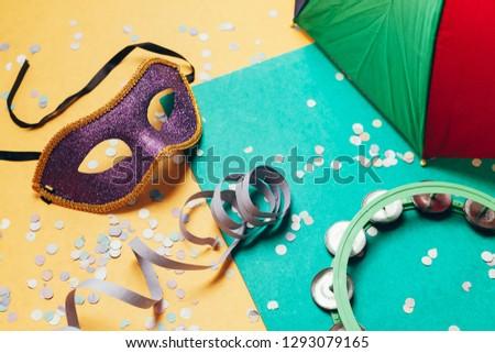 Brazilian Carnival concept. Mask and confetti on over background #1293079165