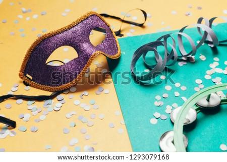 Brazilian Carnival concept. Mask and confetti on over background #1293079168