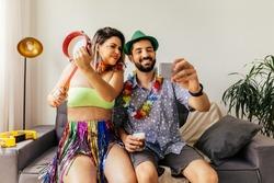 Brazilian Carnival. Couple celebrating carnival at home