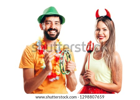 Brazilian Carnival. Couple in costume enjoying the carnival party on white background #1298807659