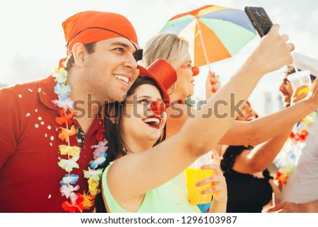 Brazilian Carnival. Couple in costume taking a self portrait #1296103987