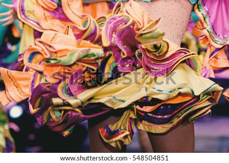 Brazilian Carnival. Dancing in bright tropical colors. Toning.Shallow depth of field. #548504851