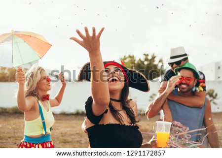 Brazilian Carnival. Group of Brazilian people in costume celebrating the carnival party in the city #1291172857
