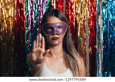 Brazilian Carnival. Woman gesturing stop sign with hand. Concept public harassment #1297795684