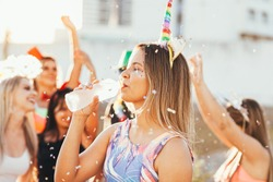 Brazilian Carnival. Woman in costume drinking water