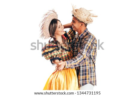 Brazilian couple wearing traditional clothes for Festa Junina - June festival - dancing isolated on white background #1344731195