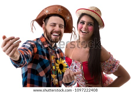 Brazilian couple wearing traditional costume for Junina Party #1097222408