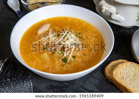 Brazilian cuisine - Chicken soup or Canja de galinha in portuguese - Traditional Brazil dishes, soup with chicken and rice.