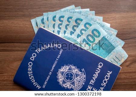 Brazilian document work and social security ( Carteira de Trabalho e Previdencia Social) with brazilian money
