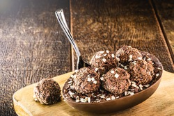 brazilian easter dessert, chocolate egg with cream filling, brazilian brigadier bonbons, biscuit and sugar, called a spoon egg