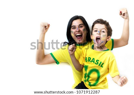 Brazilian family cheering together. Fans celebrating over white background. Painted faces and cheering